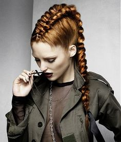 A Long Red straight coloured plaited braids ponytail sculptured womens hairstyle by Schwarzkopf. This look is femme, yet tough. I love it!
