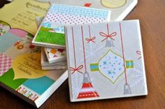 Jingle Bell Tile Coasters  These Jingle Bell Tile Coasters from DCWV make great Christmas crafts!  Made with colorful holiday paper, these coasters are great for having on display at your holiday party.  Christmas paper crafts like this also make great gifts for neighbors, as well as fun stocking stuffers.