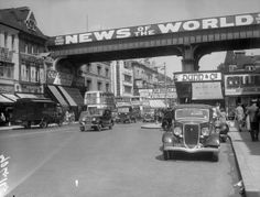 Traffic in Brixton High Street south London spanned by a railway... News Photo 3350987