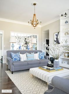 grey-sofa-tonic-living-pillows-blue-and-white-spring-decor-transitonal-living-rom.jpg 1,080×1,467 pixels