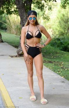 Sizzling: The TOWIE girls are engaging in bikini wars as illustrated by Georgia Kousoulou who sizzled in a racy black number as she joined newbie Amber Dowding ahead of filming on Monday