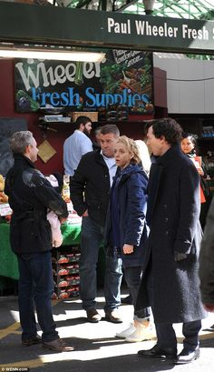 In among the action: The cast and crew caused quite a stir as they filmed Sherlock during the busy lunchtime period at the market