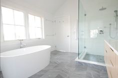 Dark grey marble floor. Matching small tile in shower, is this a step down? Nice white outline around shower