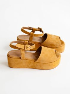 """Open-toed platform sandal. Buckle ankle stape. 2.75"""" wrapped platform. Made in Turkey. 100% suede leather. Color: Saddle brown suede"""