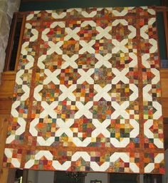 """A split nine patch variation by Debbie Caffreys book, """"Open A Can Of Worms"""".  I hope I credited that right.  Beautiful quilt, and I must make it."""