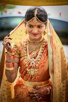 Traditional South Indian bride wearing bridal saree, jewellery and hairstyle. #IndianBridalMakeup #IndianBridalFashion # #TeluguWedding #TeluguBride #Telugu #kanjeevaram # saree #wedding #Bride