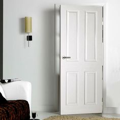 White primed 4 panel door with smooth surfaces and a moulded raised and fielded effect, a low cost door. 4 Panel Interior Door, Painted Interior Doors, Interior Walls, Interior Design, Internal Door Handles, Internal Doors, White Panel Doors, Bathroom Door Handles, Hollow Core Doors