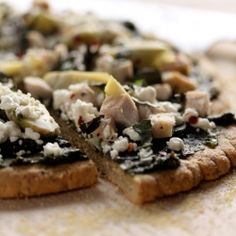 Homemade Gluten-free Pizza with [leafy green] Pesto and Goat cheese!