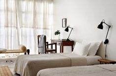 salvaged cabinet, guest room,  fabric chandeliers, baskets. Satyagraha HouseSatyagraha House