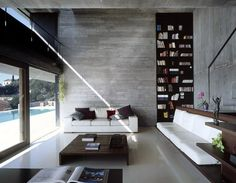 love the concrete walls and floors combined with the oversized windows