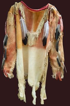 SIOUX ca. 1870 buckskin (brain tanned or smoked), feathers, clay pigment paints, trade cloth, glass and brass beads, etc