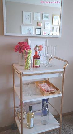 Tried and true! DIY IKEA bar cart hack. I added contact paper to the shelves to add some elegance. Everyone thought I spent $400 on the bar cart, not $40 at IKEA