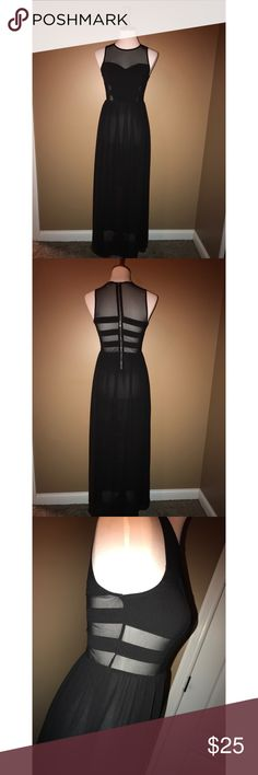 Black maxi dress Black maxi dress, see-through panels, bottom 1/2 of skirt is see through also Dresses