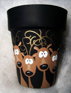"flower pots outdoor This beautiful hand painted terracotta pot that is painted with cute little Reindeer. I call this ""Reindeer in Headlights"". The reindeer are painted chocolate b Flower Pot Crafts, Clay Pot Crafts, Christmas Projects, Holiday Crafts, Painted Flower Pots, Painted Pots, Hand Painted, Painted Pebbles, Noel Christmas"