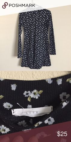 Turtle neck flower print long sleeve sweater dress Turtle neck flower print long sleeve skater style sweater dress. Very flattering, perfect to wear with tights for winter weather. Lush Dresses Long Sleeve