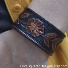 Leather floral tooled leather cuff bracelet by LoveSquaredDesigns Love the combination of black and brown! This is one of a kind! Only one available!