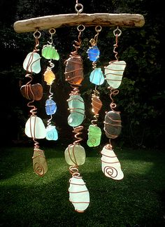 Great idea for displaying beach glass. Just get creative with copper wire, some eye hooks, and a stick. (No directions, just a photo, but it's pretty self explanatory.)