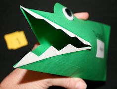 Alligator greater than and less than manipulative.  Made from an envelope.  Kids can put numbers or counters in the alligator's mouth.