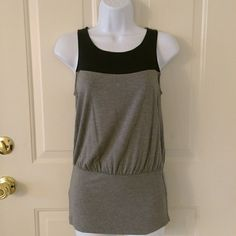 Grey and Black Color Block Tank NWT grey and black color block tunic tank top from The Limited. Black section on top is semi-sheer, as shown in third picture.  Top is tunic style, so the fit is longer.  Size XS. The Limited Tops Tank Tops
