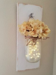 This is my take on a farmhouse chic wall sconce. It is so simple and shabby but at the same time very elegant. It measures 14 long and 5.5 wide, it includes one hanging mason jar with a string of fairy lights. The jar has been frosted to give the lights a softer look. Flowers are included. You can choose a finish for your sconce and leave me a note in the notes to seller box at checkout with your finish choice. Please do note hesitate to ask if you have any questions! I ship priority with…