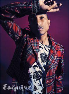Pharrell dons a plaid biker jacket by Black Comme des Garçons with a graphic Junya Watanabe t-shirt.
