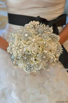 For a winter wedding, this Brooch bouquet looks like Snowflakes, which I Love. Of course I'd add fresh flowers.