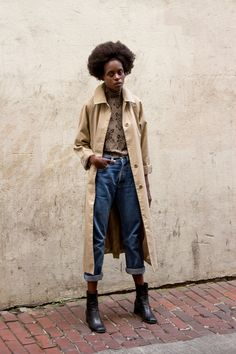 Favour Kibali photographed by Josie Simonet. Trench on floral top, boyfriend denim and ankle boots.