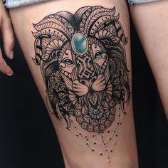 Found this amazing tattoo on the internet! Lion mandala tattoo with blue gem