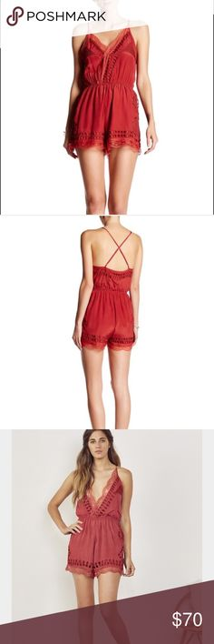 "Tularosa Charmer Lace Romper Brand new with tags Tularosa red Romper with lace trim. Sheer lace accents and geometric eyelets add intriguing texture to a flirty sleeveless romper topped with a daringly deep V-neckline. 22"" center front length; 2 1/2"" inseam; 25"" leg opening (size Medium). V-neck. Sleeveless. Adjustable straps. Lined. 100% viscose. Tularosa Pants Jumpsuits & Rompers"