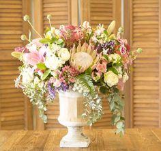 Rustic wedding flower arrangement with protea