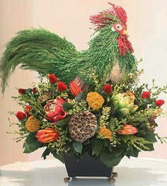 This handsome Rooster arrangement  is created with fine grasses and floral textures that seem to come to life. Designed by Forever Green Art.