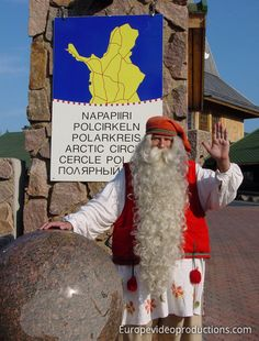 Santa Claus and Arctic Circle line in Rovaniemi in Finnish Lapland in summertime
