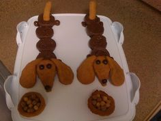 DACHSHUND CUPCAKES..CHOCOLATE CUPCAKES AND PEANUT BUTTER COOKIES FOR THE HEAD AND TAIL AND DOG BOWL..