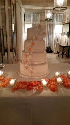 Lovely white and coral orchids cascade down this beautiful wedding cake. Beautiful Wedding Cakes, Custom Cakes, Yummy Cakes, Orchids, Coral, Baking, Desserts, Personalized Cakes, Tailgate Desserts