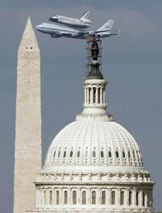 On it's final mission, the Space Shuttle Discovery passes the Washington Monument and the U.S. Capitol atop a NASA modified 747 plane in Washington April 17, 2012.