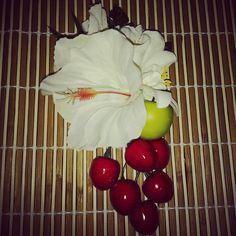 White tropical flowers with cascading cherries and apple...available for $15 plus shipping...leave your email to purchase:) #deadlydinaaccessories #whiteflowers #cherries #apple #tikioasis #rocknluau #luau #tiki #tropical #hawaiin #hairflowers #hairpiece #hairaccessories #retro #pinup #rockabilly #vintage