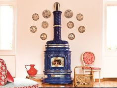 Estufa de leña de cerámica con acumulación de calor CORSARA by Sergio Leoni