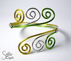 spring greens swirl wave cuff bangle bracelet. green, yellow and silver wire wrapped. Jewellery (jewelry) handmade in Scotland by Selkie Crafts.