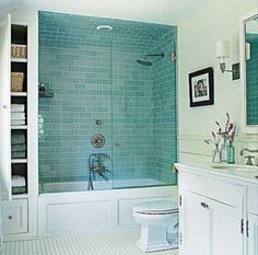 Beautiful blue, mint & teal glass subway tile. Amazing built in storage!