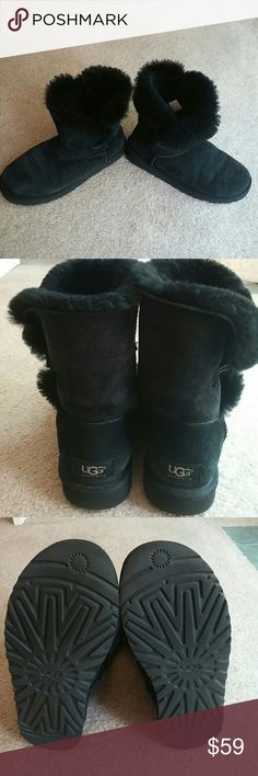 Authentic Short bailey button black ugg boots These boots have minimal wear to them and are still in great condition. Fluffy fur, very little wear on bottoms. Sides fold over slightly with minimal creasing. No tears or stains. Protected with ugg spray UGG Shoes Winter & Rain Boots