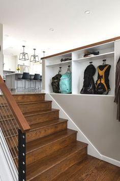 Here's an entryway idea for you! For more entryway storage, use built ins! We replaced the railing with a deep pony wall with recessed niches to store backpacks and purses, complete with integrated outlets for charging devices! Creative storage, back to school help