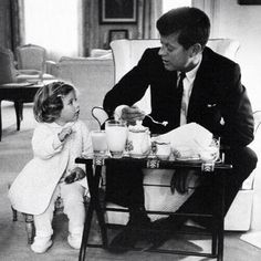 JFK and Caroline Kennedy having a tea party.