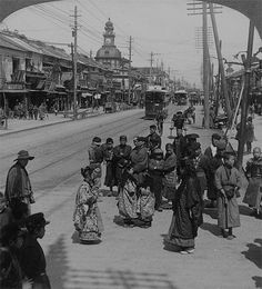 The Ginza (looking north) the most important thoroughfare in Tokyo, Japan 1904 (People gathered on busy street in Tokyo.)