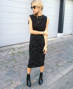 Black and black. Love the pointed boots, so in.
