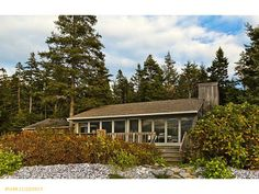 Indian Head Camps in Tremont, Maine. This property is listing by The Swan Agency Sotheby's International Realty.