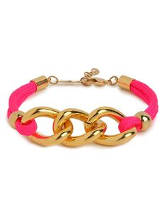 Go ahead — have your fun and your glitz, too. This playful bracelet features both nautical rope details, in vibrant fuchsia, and glamorous gold chain links.