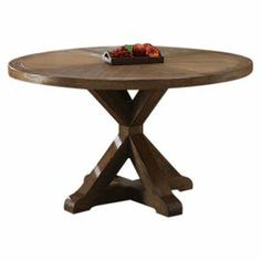 """Showcasing an x-shaped pedestal base and natural elm finish, this rustic table hosts both celebratory dinners and family game nights in style.  Product: Dining tableConstruction Material: Solid ash wood and elm veneerColor: Natural elm and rustic pineDimensions: 30"""" H x 54"""" Diameter"""