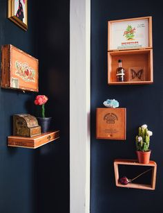 Cigar box shelves and curios A Creative Couple's Studio in Hell's Kitchen Cigar Box Diy, Cigar Box Crafts, Cigar Art, Cigar Boxes, Wine Boxes, Studio Apartment, Apartment Therapy, Zigarren Lounges, Cigar Box Projects