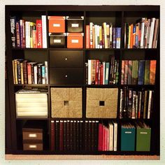 Organize Your Books, CDs and DVDs   Jennifer Ford Berry; DO THIS to organize DVDs, except get 2 of the smaller book cases & put one on each side of the fireplace