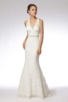 Ivory re-embroidered lace v-neck trumpet gown with keyhole back and pearl and crystal encrusted belt. Sweep train.    Sizes: 0-24    Colors: IVORY    Fabrics: Re-embroidered Lace    Available Colors: WHITE AND IVORY  For Wedding Accessories,visit us.  http://www.bridesadvantage.com